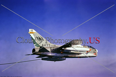 A-7USN-VA-215 019 A flying Vought A-7B Corsair II USN attack jet, VA-215 BARN OWLS, USS Oriskany, NM code, modified as an aerial tanker, by Robert Lawson via Stephen W  D  Wolf collection    CCC_0300     Dt