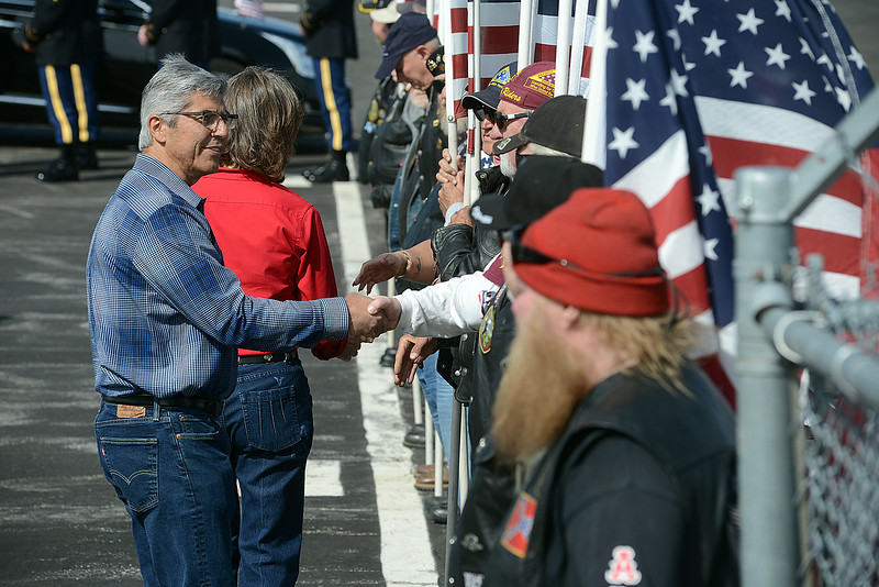 Bob and Donna Conde, parents of fallen soldier Gabereil Conde, shake the hands of Patriot Guard Riders after their son's body arrived Friday morning, May 11, 2018, at the Northern Colorado Regional Airport in Loveland.  (Photo by Craig Young/Loveland Reporter-Herald)