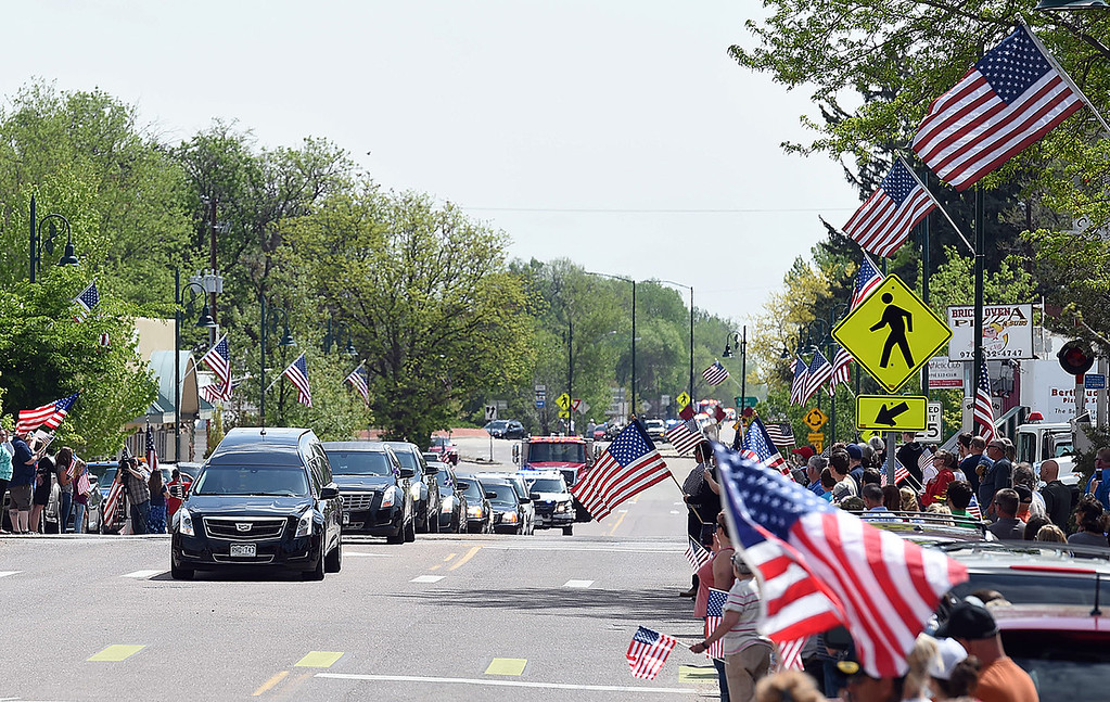 . People line Mountain Avenue in Berthoud waving American flags as the procession carrying fallen soldier Gabriel Conde passes by on Friday, May 11, 2018, on its way to the funeral home in Longmont. (Photo by Jenny Sparks/Loveland Reporter-Herald)