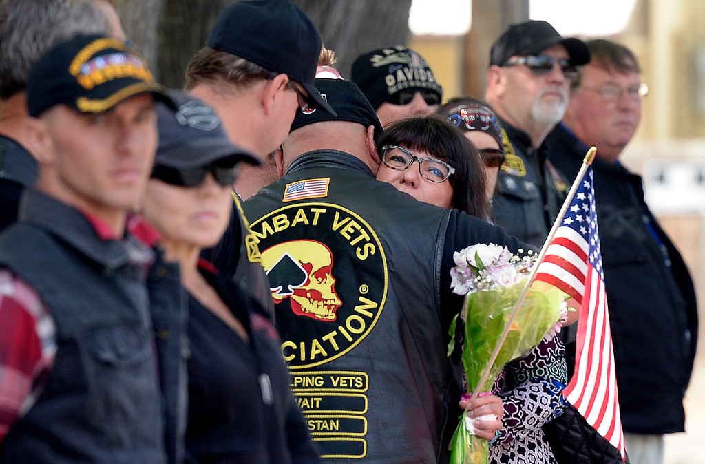 . A family member of Gabe Conde hugs a Patriot Guard Rider as the flag-draped coffin of U.S. Army Spc. Gabe Conde arrived at the Howe Mortuary & Crematory on Friday in Longmont. Conde was killed in action last week in Afghanistan. For more photos go to dailycamera.com Jeremy Papasso/ Staff Photographer 05/11/2018