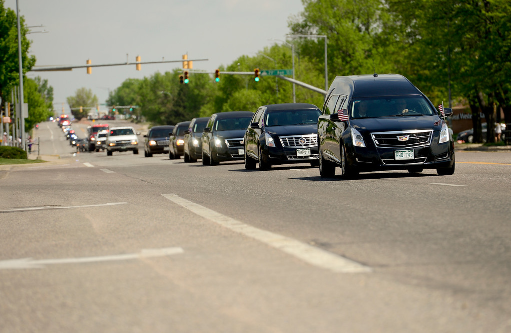 . The hearse carrying the body of Berthoud High School graduate and U.S. Army Spc. Gabriel Conde is seen on Main Street in Longmont, Colorado on May 11, 2018. Conde was killed in action while serving in Afghanistan. (Photo by Matthew Jonas/Staff Photographer)