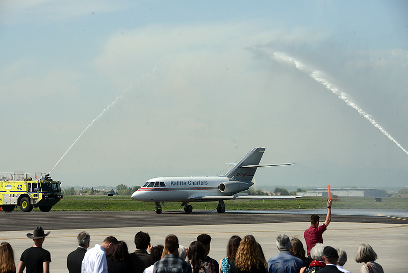 Firetrucks spray an arc of water over a jet carying the body of  Spc. Gabriel Conde as it taxis onto the tarmac Friday morning, May 11, 2018, at the Northern Colorado Regional Airport in Loveland.  (Photo by Craig Young/Loveland Reporter-Herald)