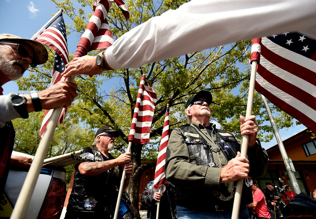 . Patriot Guard Riders Jim Herstein, left, Greg Westfall and Ralph Walters hold American flags before forming a flag line as the flag-draped coffin of U.S. Army Spc. Gabe Conde arrived at the Howe Mortuary & Crematory on Friday in Longmont. Conde was killed in action last week in Afghanistan. For more photos go to dailycamera.com Jeremy Papasso/ Staff Photographer 05/11/2018