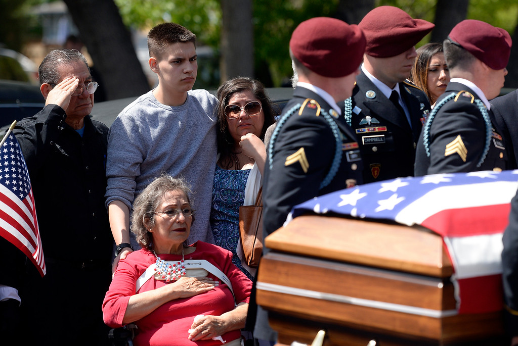 . Family members watch as the flag-draped coffin of U.S. Army Spc. Gabe Conde arrived at the Howe Mortuary & Crematory on Friday in Longmont. Conde was killed in action last week in Afghanistan. For more photos go to dailycamera.com Jeremy Papasso/ Staff Photographer 05/11/2018