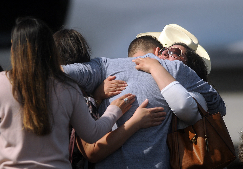 . Friends and family of Spc. Gabriel Conde console each other as his body arrives Friday morning, May 11, 2018, at the Northern Colorado Regional Airport in Loveland.  (Photo by Duncan Young/Loveland Reporter-Herald)