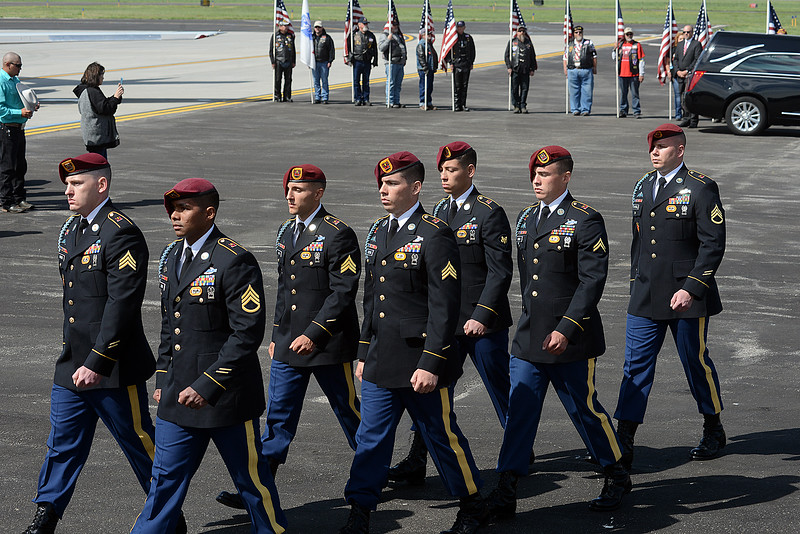 Army honor guard walk away after carrying the casket of Spc. Gabriel Conde past flag-bearing Patriot Guard Riders on Friday morning, May 11, 2018, from the airplane to the hearse on the tarmac of the Northern Colorado Regional Airport in Loveland.  (Photo by Craig Young/Loveland Reporter-Herald)
