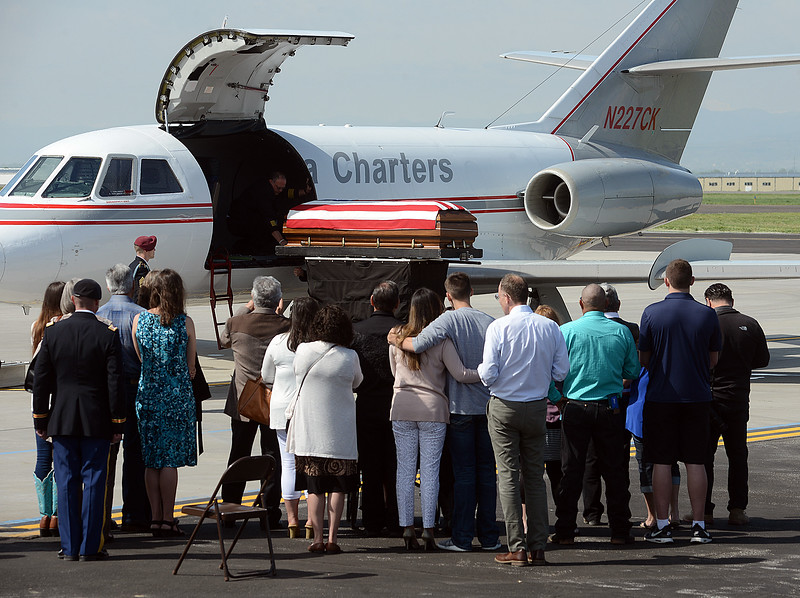 Friends and family of Spc. Gabriel Conde watch as the casket holding his body is unloaded from an airplane Friday morning, May 11, 2018, on the tarmac of the Northern Colorado Regional Airport in Loveland.  (Photo by Craig Young/Loveland Reporter-Herald)