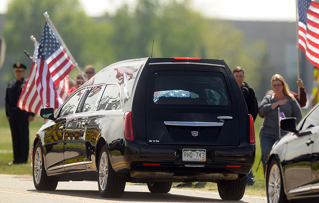. The flag-draped casket carrying the body of Spc. Gabriel Conde is seen through the window of a hearse on Friday morning, May 11, 2018, as it leaves the Northern Colorado Regional Airport in Loveland.  (Photo by Duncan Young/Loveland Reporter-Herald)