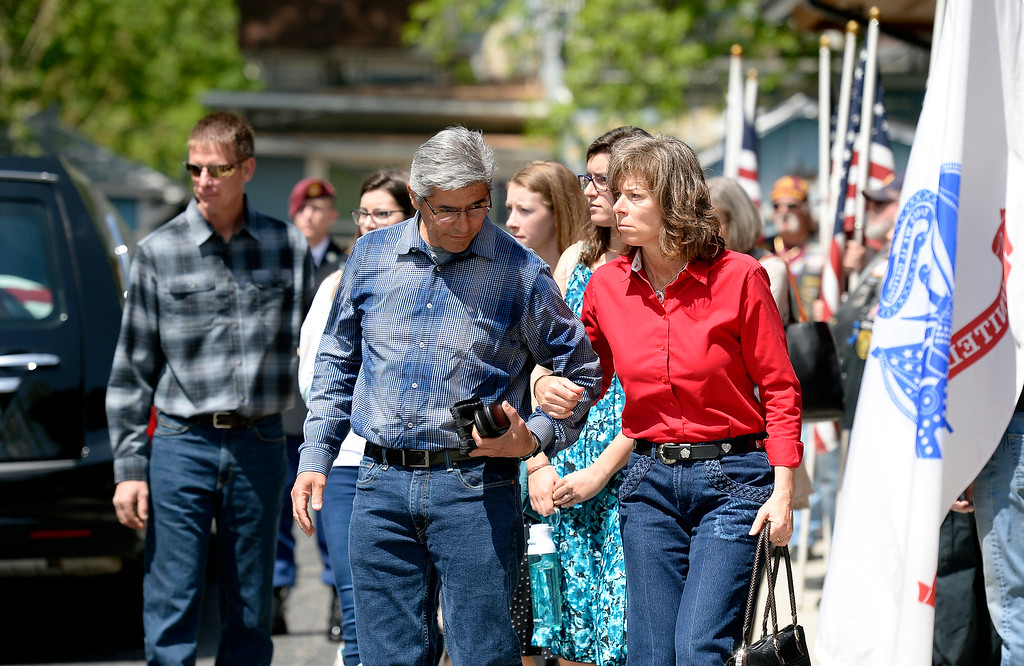. The parents of Gabe Conde walk past a flag line of Patriot Guard Riders as the flag-draped coffin of U.S. Army Spc. Gabe Conde arrived at the Howe Mortuary & Crematory on Friday in Longmont. Conde was killed in action last week in Afghanistan. For more photos go to dailycamera.com Jeremy Papasso/ Staff Photographer 05/11/2018
