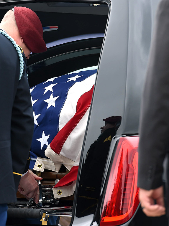 . Soldiers from Spc. Gabriel Conde\'s company load his flag-draped casket into a hearse after his memorial service on Saturday, May 12, 2018, at LifeBridge Church in Longmont.  (Photo by Jenny Sparks/Loveland Reporter-Herald)