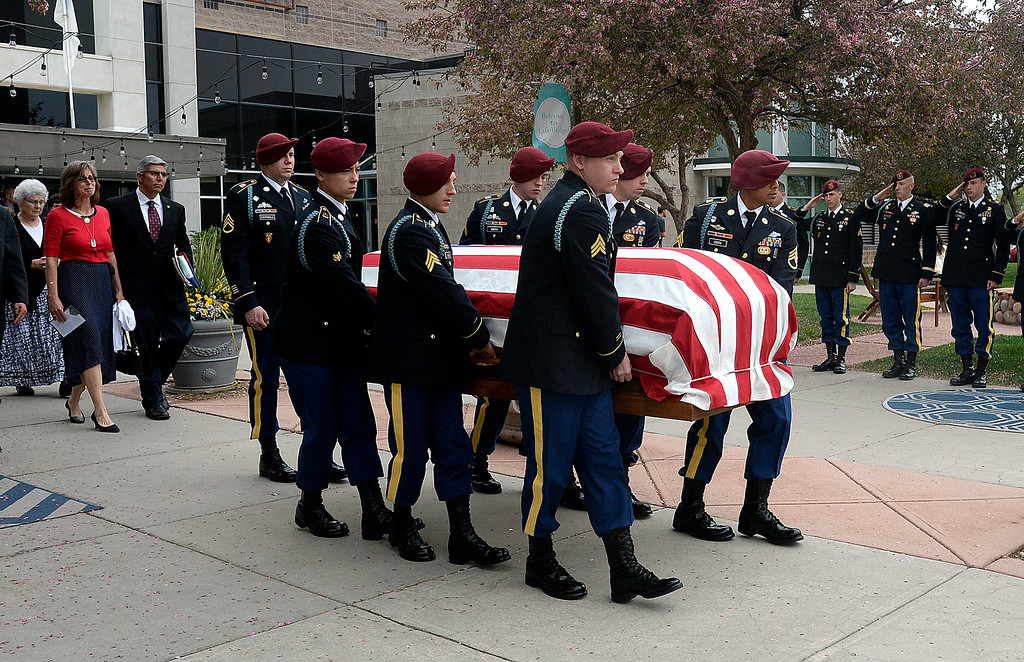 . Soldiers from Spc. Gabriel Conde\'s company load carry flag-draped casket out of the church as his parents, Bob and Donna Conde follow after his memorial service on Saturday, May 12, 2018, at LifeBridge Church in Longmont.  (Photo by Jenny Sparks/Loveland Reporter-Herald)