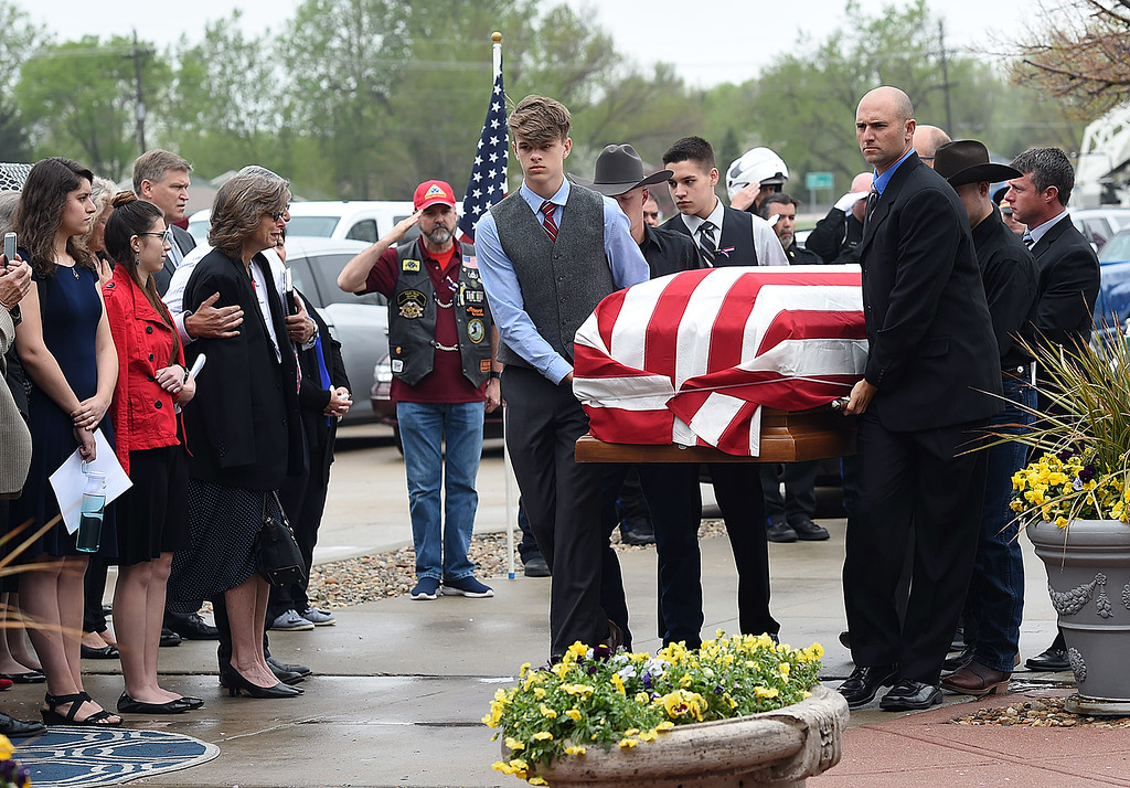 . Pallbearers carry the flag-draped casket holding fallen soldier Spc. Gabriel Conde past his parents, family and friends into the church before his memorial service on Saturday, May 12, 2018, at LifeBridge Church in Longmont.  (Photo by Jenny Sparks/Loveland Reporter-Herald)