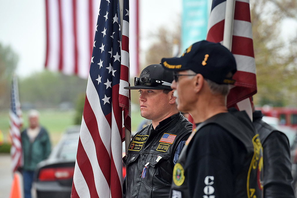 . James Caldwell with the Combat Veterans Motorcycle Association holds an American flag and stands with Partiot Guard Riders lining the entrance of the church beforethe memorial service for fallen soldier Spc. Gabriel Conde on Saturday, May 12, 2018, at LifeBridge Church in Longmont.  (Photo by Jenny Sparks/Loveland Reporter-Herald)