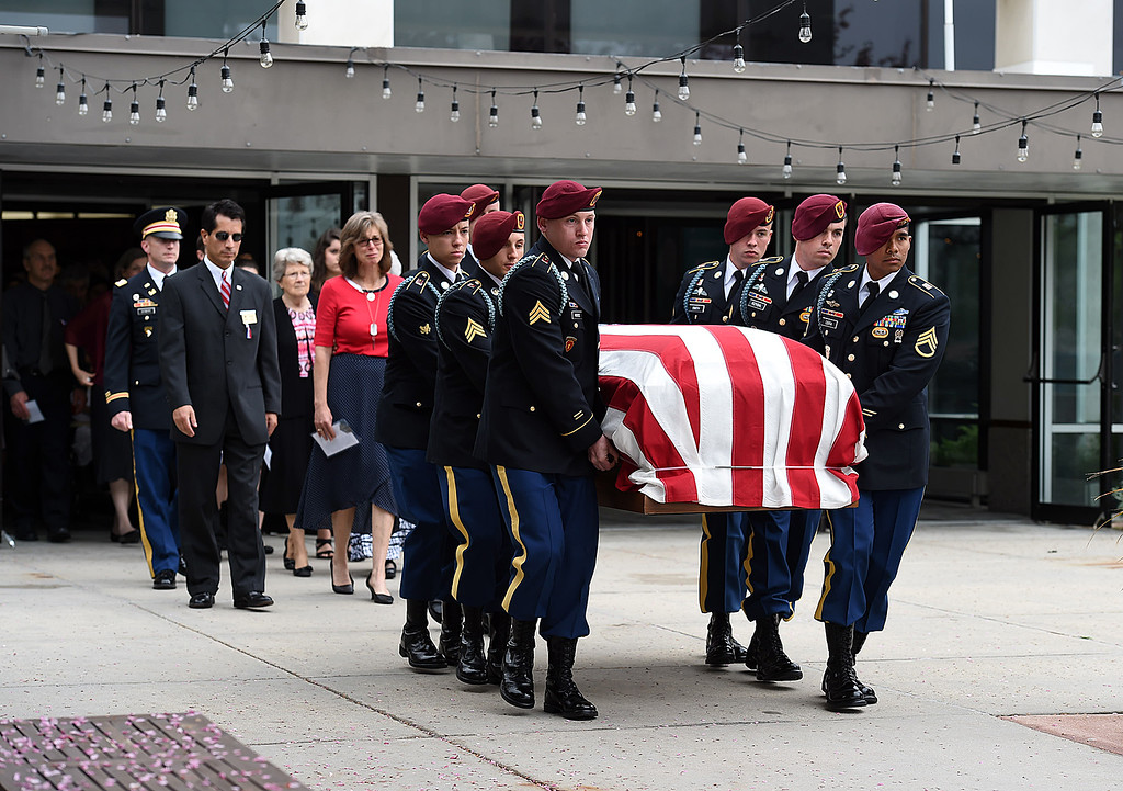 . Soldiers from Spc. Gabriel Conde\'s company carry his flag-draped casket out of the church after his memorial service on Saturday, May 12, 2018, at LifeBridge Church in Longmont.  (Photo by Jenny Sparks/Loveland Reporter-Herald)