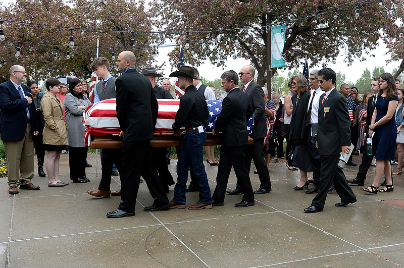 Pallbearers carry the flag-draped casket holding fallen soldier Spc. Gabriel Conde into the church as his parents, family and friends follow before his memorial service on Saturday, May 12, 2018, at LifeBridge Church in Longmont.  (Photo by Jenny Sparks/Loveland Reporter-Herald)