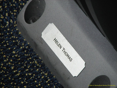 The front row seat of Helen Thomas in the Briefing Room.  Seats are assigned by the members of the White House Press Corps.