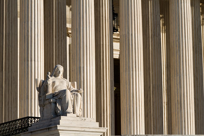 Contemplation of Justice Sculpture, Supreme Court Building, Washington DC.   On either side of the main steps of the Supreme Court Building are seated marble figures. These large statues are the work of sculptor James Earle Fraser. On the left is a female figure, the Contemplation of Justice.