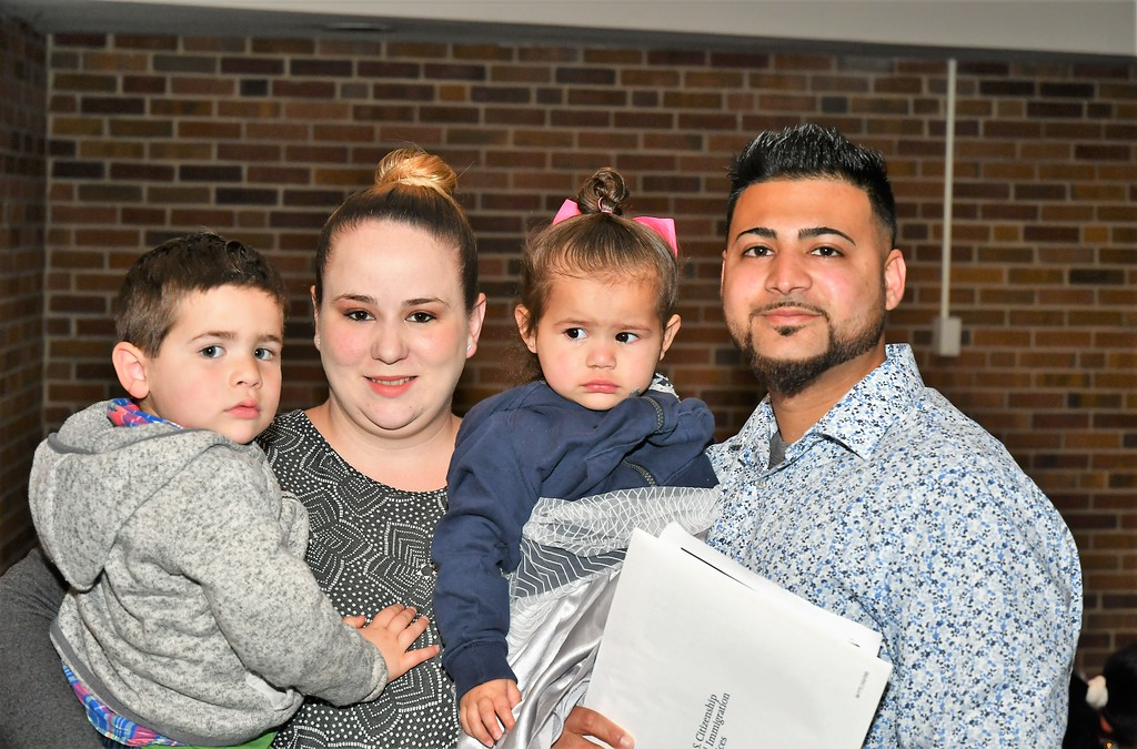 . Elijah, Kasey and Alexa Clarance are with Father and Husband, Leon Clarance who became a U.S. Citizen.  Leon is from Pakistan and the family lives in Worcester, Mass. Sentinel & Enterprise / Jim Fay