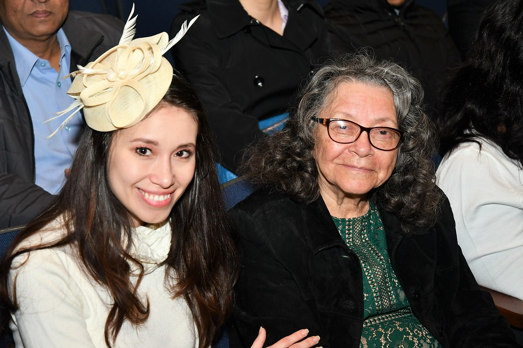 . Emma Lopez, who became a U.S. Citizen, was accompanied by her Grand Daughter, Valery Miranda.  Emma is from Peru and lives in Billerica, Mass. Sentinel & Enterprise / Jim Fay