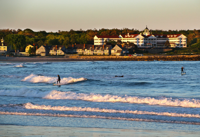 Kennebunk Maine, Surfers in Wave at Dusk