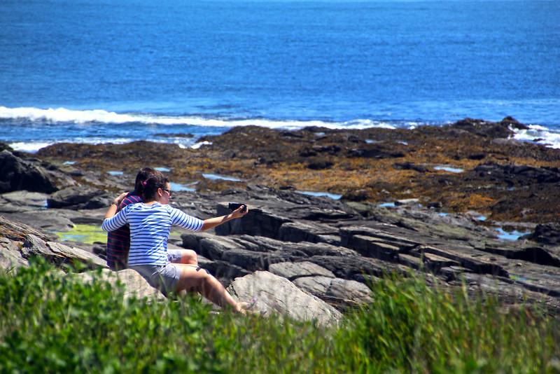 Cape Elizabeth Maine, Couple Photographing Selfies on Rocks