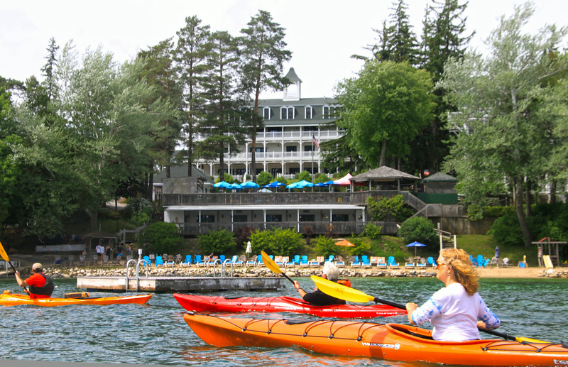 Elkhart Lake Wisconsin, Kayakers passing Victorian Village