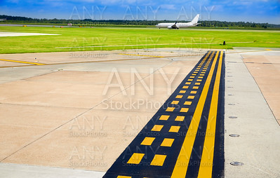 Airport signals in pavement with aircraft