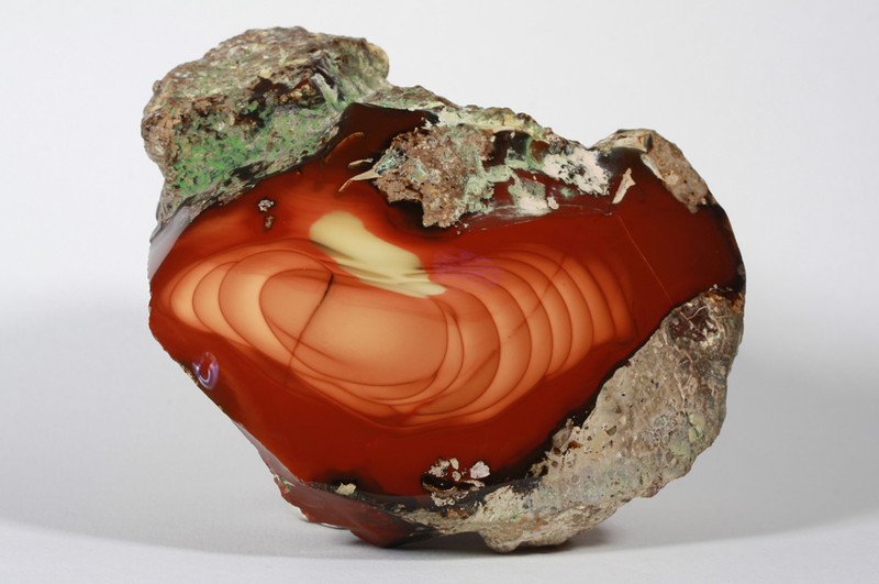 "SOLD: Bruneau Jasper   Bruneau River Canyon near Filer, Idaho  <br /> This cherry red beauty is free from cracks and has a complete pattern, a perfect cabinet specimen. The yellow area above the central orb is not a reflection, it provides a  color accent to this fine jasper. Dome cut.<br /> 4 x 2 1/2 x 3"" 1.75 lb"