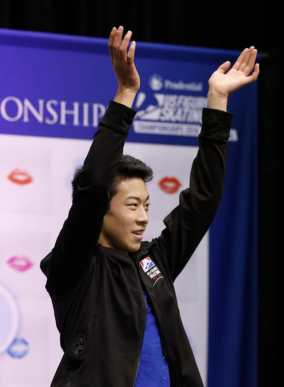 . Nathan Chen celebrates after he completed the men\'s free skate program of the U.S. Figure Skating Championships, Sunday, Jan. 24, 2016, in St. Paul, Minn. Chen picked up the bronze medal in the men\'s program. (AP Photo/Jim Mone)
