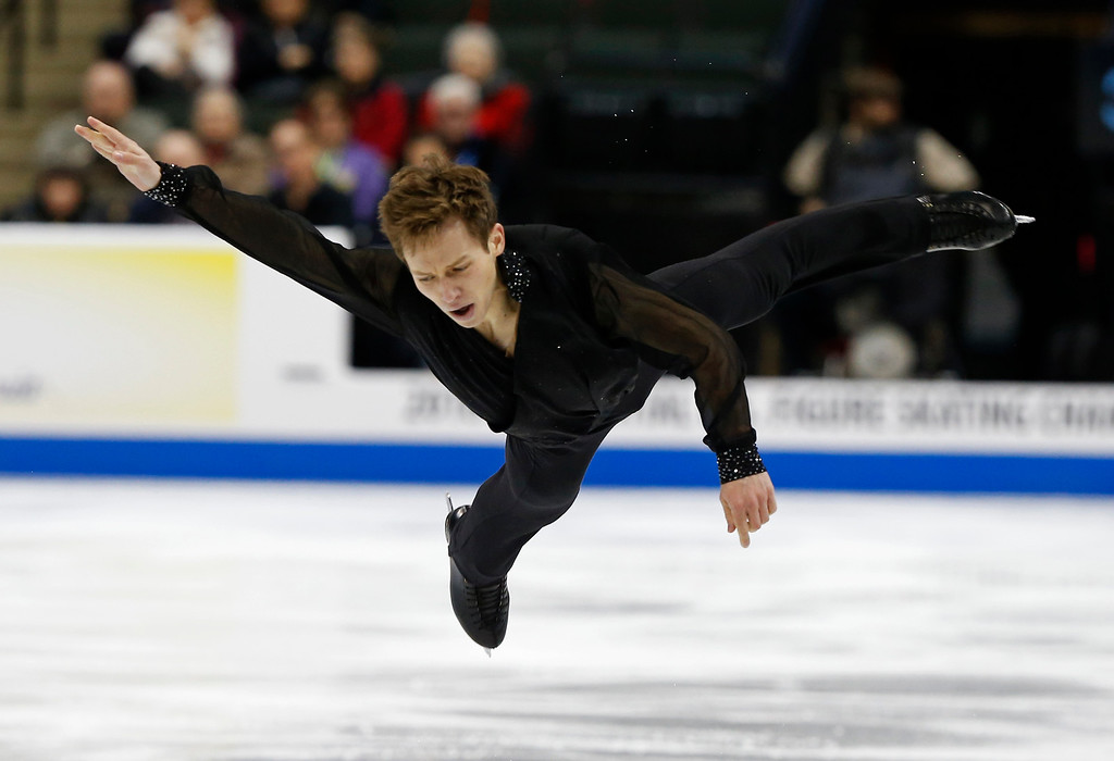 . Grant Hochstein goes airborne as he competes in the men\'s free skate program of the U.S. Figure Skating Championships, Sunday, Jan. 24, 2016, in St. Paul, Minn. (AP Photo/Jim Mone)