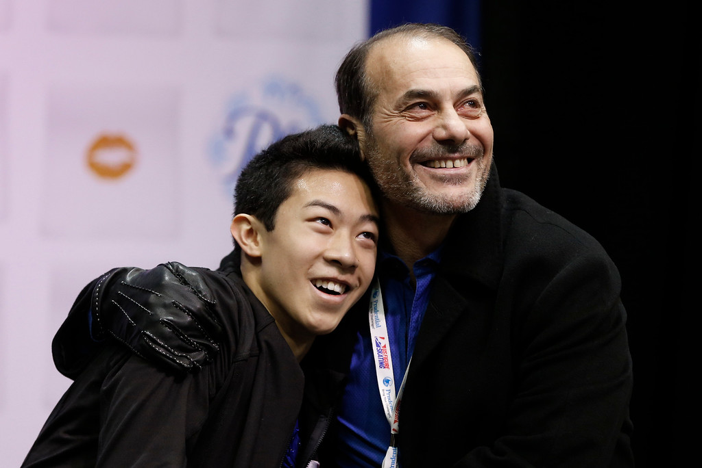 . Nathan Chen, left, gets a hug from coach Rafael Arutyunian after he completed the men\'s free skate program of the U.S. Figure Skating Championships, Sunday, Jan. 24, 2016, in St. Paul, Minn.  (AP Photo/Jim Mone)