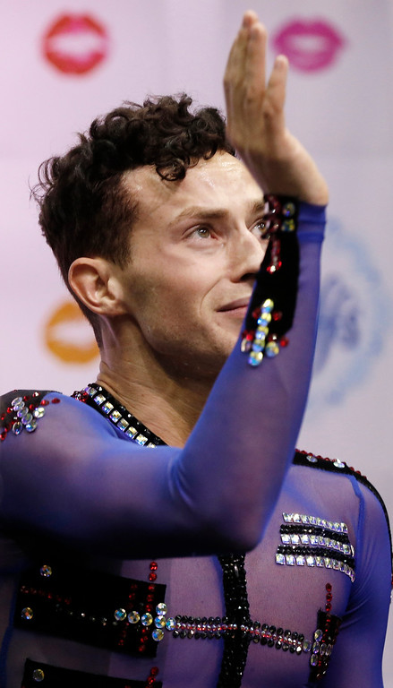 . Adam Rippon waves after moving into first place in the men\'s free skate program of the U.S. Figure Skating Championships, Sunday, Jan. 24, 2016, in St. Paul, Minn.  (AP Photo/Jim Mone)