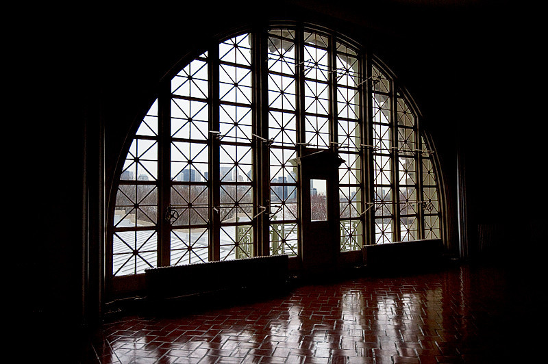 The view of the New York Skyline immigrants would have seen through the windows of the Great Hall of the Main Hall on Ellis Island while they waited for their interviews with legal inspectors
