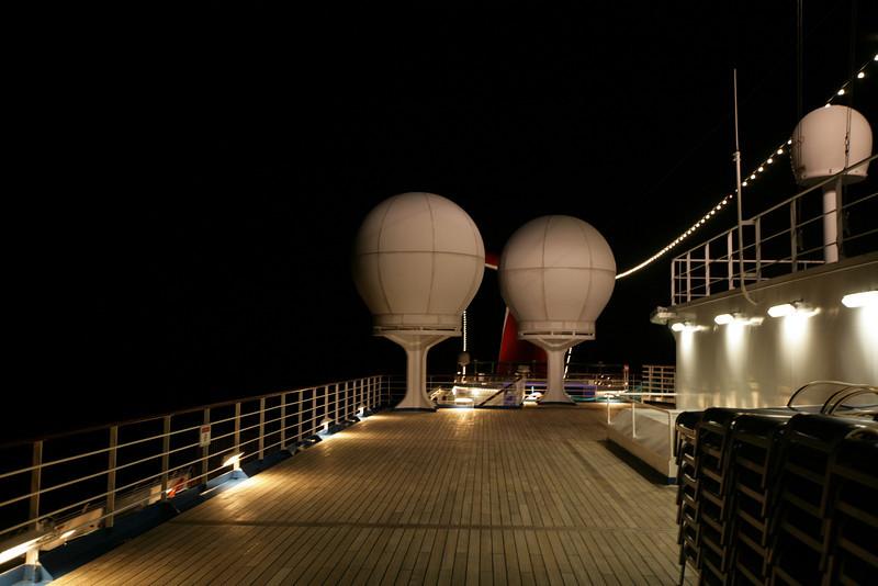 Upper deck at night. Satellite antennas in domes