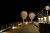 Upper deck at night. Satellite antennas in domes