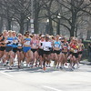 1.8 Mile: 21 seconds later, the lead pack of runners drive as one, heading west on Beacon Street.