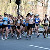 0.7 Mile: Runners at the front include Deena Kastor (#1, white cap) and Blake Russell (#17, second from right). They do not seem concerned with the early lead by #43.