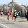 Mile 13.2: Joan Samuelson returns to Boston on Massachusetts Ave Bridge, with Cambridge and MIT's dome in the background.