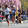 Mile 11.5: Lead pack runners grab their personal drink bottles