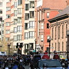 0.6 Mile: Runners come into view, heading east on Boylston, Arlington Street Church on right.