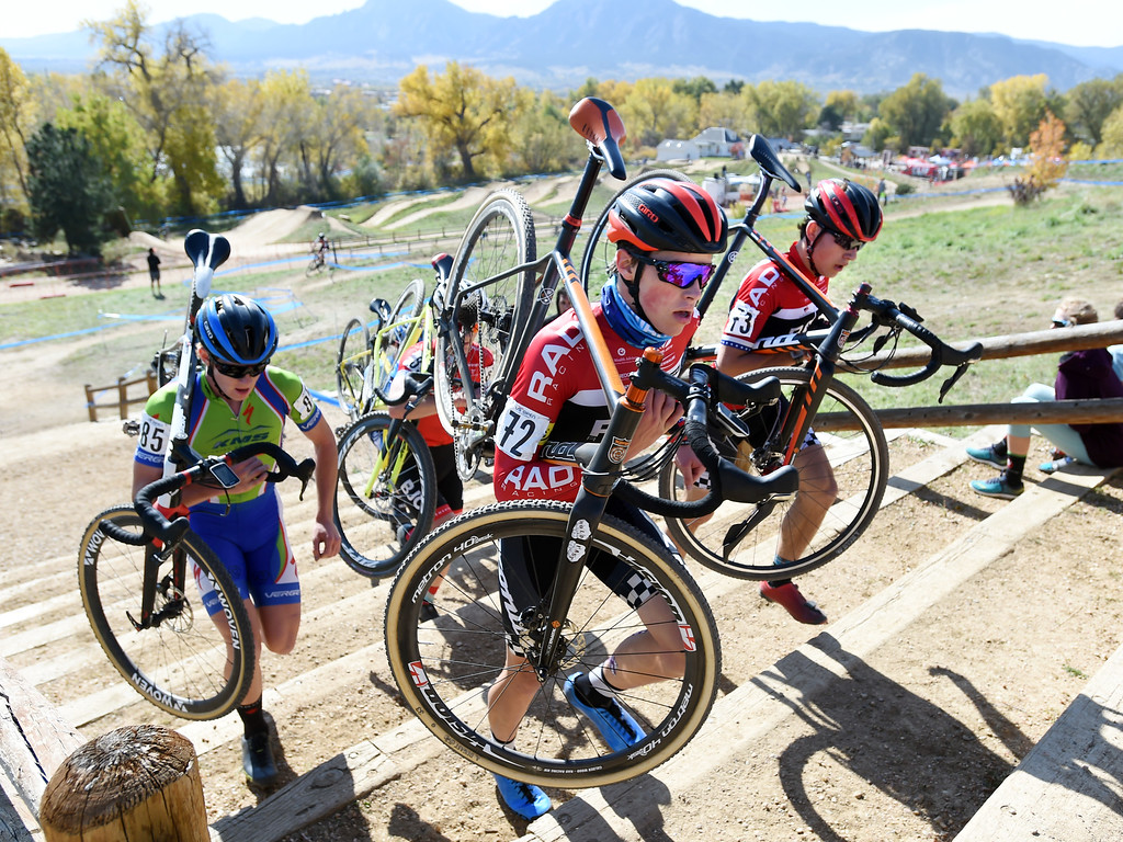 . Tyler Clark, left, Calder Wood, and Scott Funston, carry their bikes up the stairs during the Junior Men\'s race on Saturday. U.S. Open of Cyclocross returned to Valmont Bike Park in Boulder on Saturday. Events were provided for both top-level professional and amateur cyclists, including internationally-sanctioned events for Junior Men (17-18) and Under-23 Men.  For more photos, go to dailycamera.com. Cliff Grassmick  Staff Photographer October 14, 2017