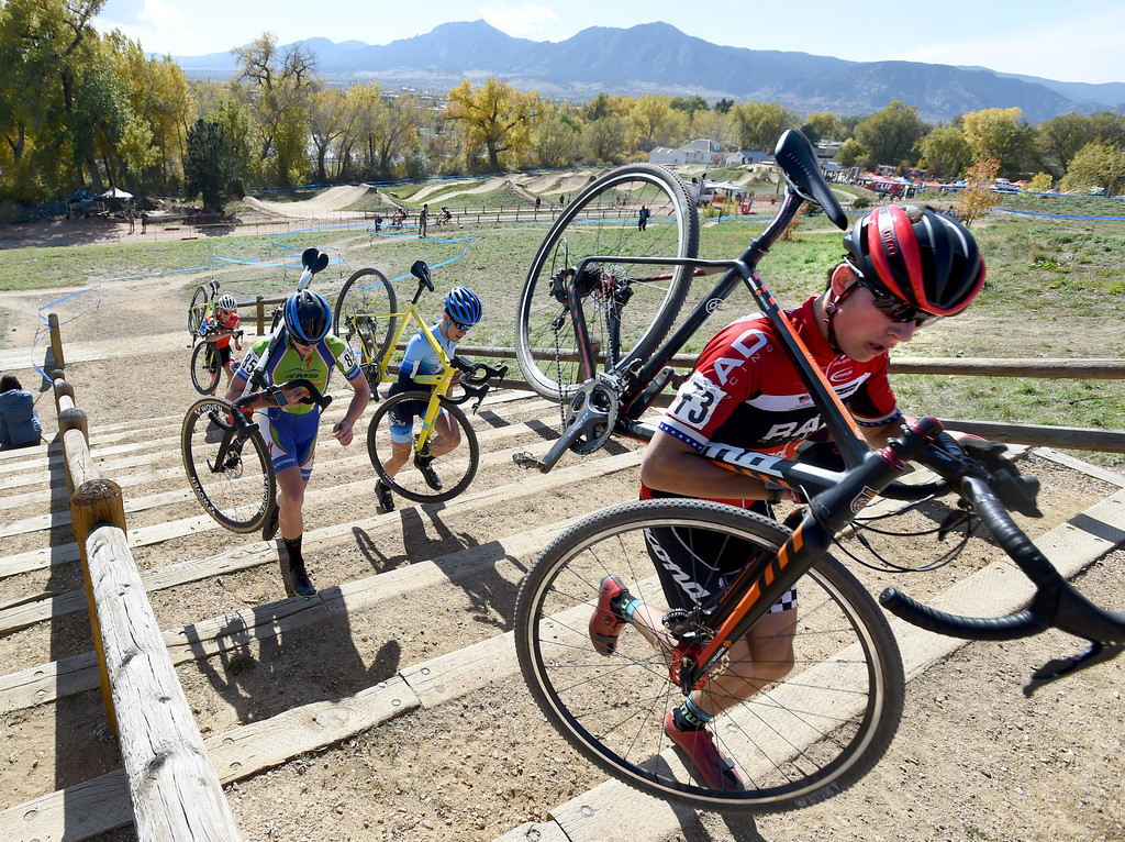 . Tyler Clark, left, Benjamin Gomez Villafane, and Scott Funston, carry their bikes up the stairs during the Junior Men\'s race on Saturday. U.S. Open of Cyclocross returned to Valmont Bike Park in Boulder on Saturday. Events were provided for both top-level professional and amateur cyclists, including internationally-sanctioned events for Junior Men (17-18) and Under-23 Men.  For more photos, go to dailycamera.com. Cliff Grassmick  Staff Photographer October 14, 2017