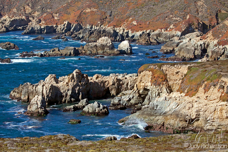 Spectacular cove along Big Sur Coastline with rugged rocks