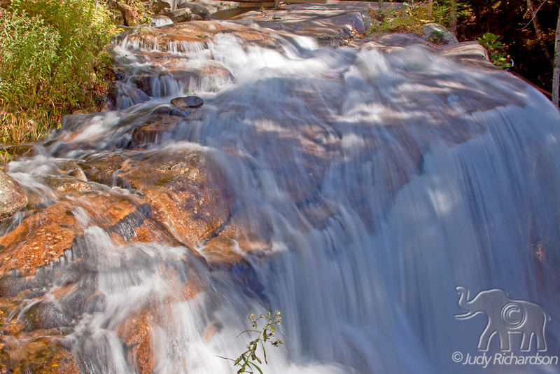 Flume Gorge upper waterfall in Franconia Notch State Park north of Lincoln, New Hampshire after heavy rains