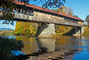 Blair Covered Bridge over the Pemigewasset River in Campton, New Hampshire with reflections and beautiful Fall foliage
