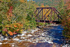 Saco River railroad bridge with beautiful Fall foliage in White Mountains of New Hampshire