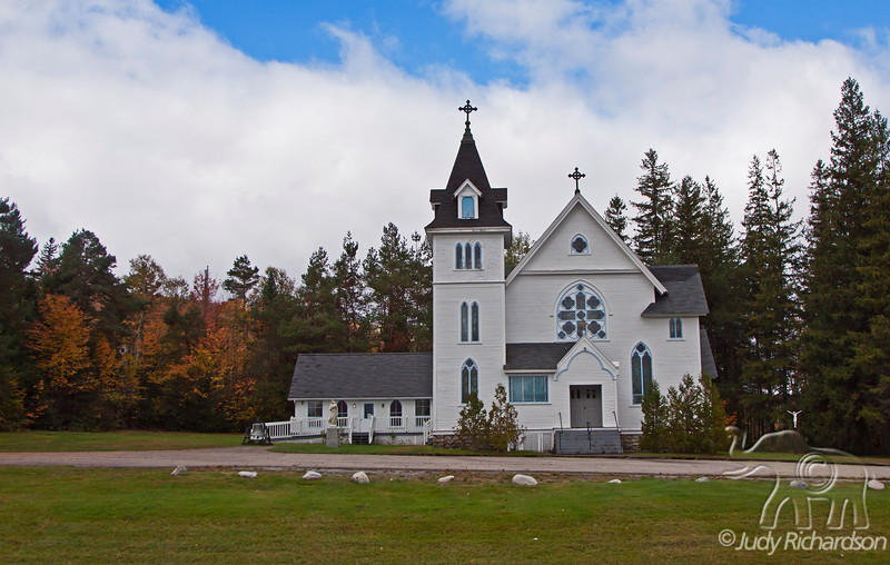 Church with Fall foliage in Franconia area of New Hampshire