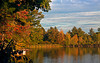 Wolfeboro Pond in late afternoon sunlight reflecting Fall colors