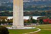 Washington Monument with US flags unfurled, Potomac River, and spectacular Fall foliage