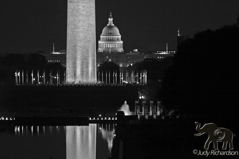 View from the Lincoln Memorial with the Washington Monument, part of the World War II Memorial, and the White House reflecting in the Reflecting Pond ~ Black and White
